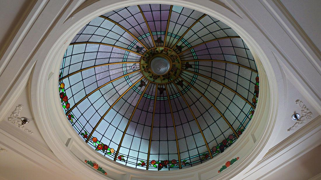 Stained glass dome ceiling inside the National Tobacco Co building